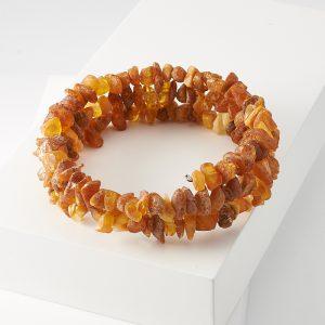 Браслет янтарь  пружина регулируемый (биж. сплав)